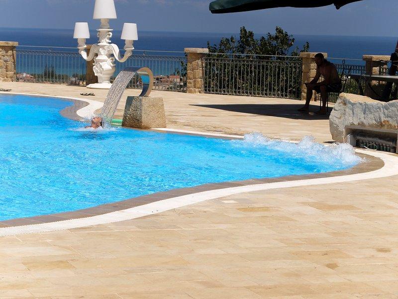 AgriturismoTerrazze sul Tirreno, appartamento trilocale con vista mare, vacation rental in Piana Calzata