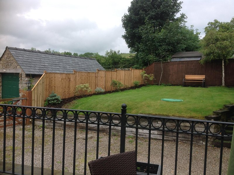 Rear Terrace with seating to rear garden area.