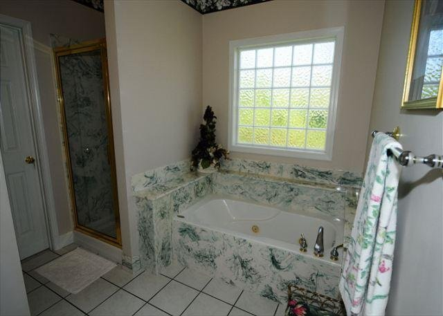 Walk in Shower & Whirlpool-Main Level King Suite