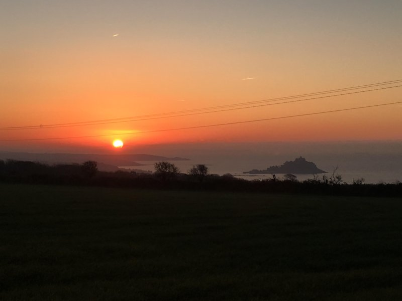 Sunrise over St Michaels Mount viewed from the balcony.
