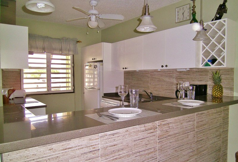 Completely renovated kitchen, with wine rack!