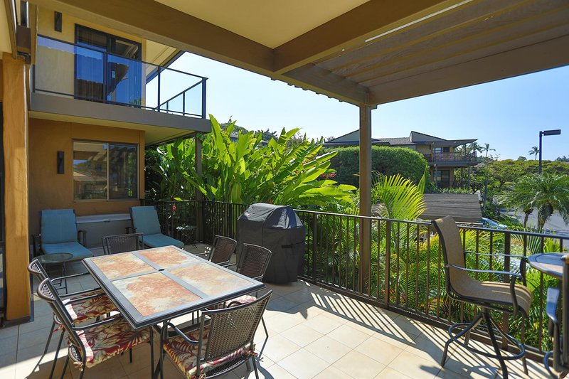 Lanai features chaise lounges, a 6-top dining table, and a private BBQ grill