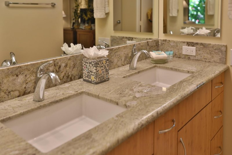 Master bathroom features twin sinks, new granite counter top, and bamboo cabinets