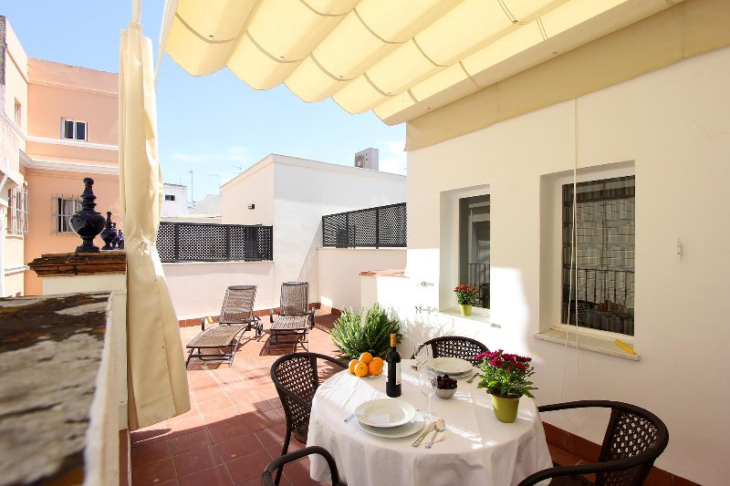 The private terrace is well-equipped with garden furniture.