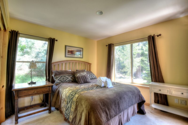 Second guest bedroom with a queen bed