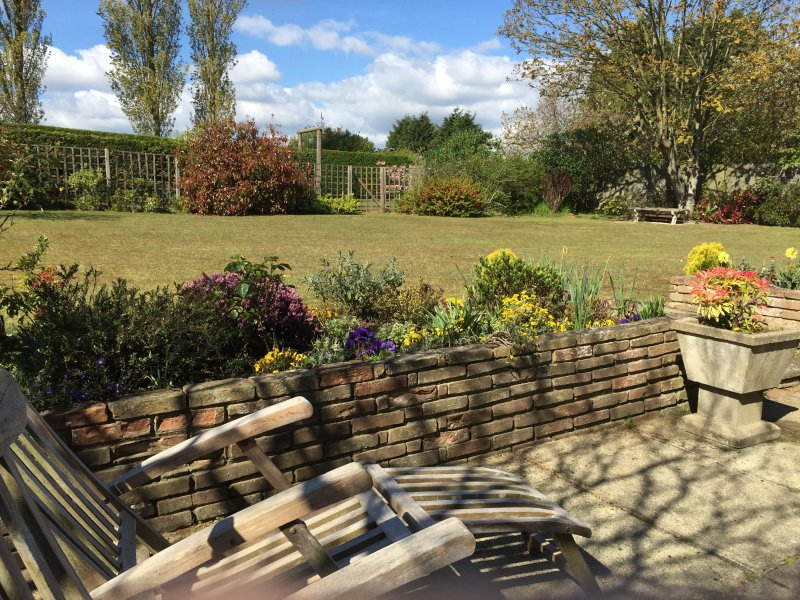 secluded fenced in back sun and BBQ garden