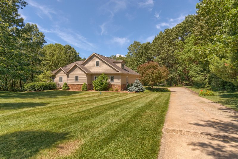 3-acre lot on private street with only three homes. Large front lawn and trails through the woods