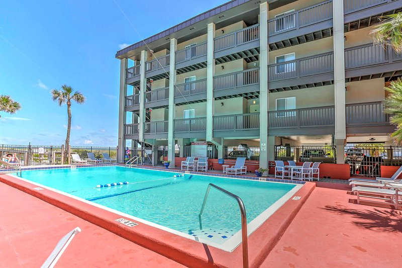 Spend your vacation mornings lounging poolside when you stay at this exclusive Fernandina Beach vacation rental condo!