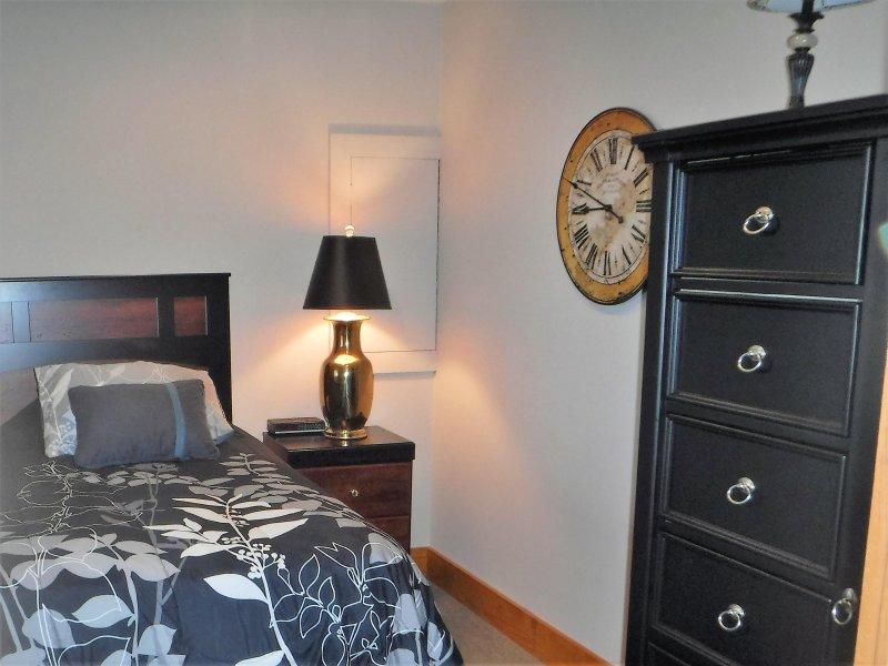 Onderste verdieping slaapkamer met een tweepersoonsbed