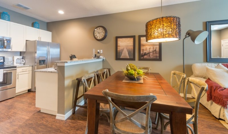 Dining table for 6 and kitchen area with breakfast bar. Perfect for dining at home.