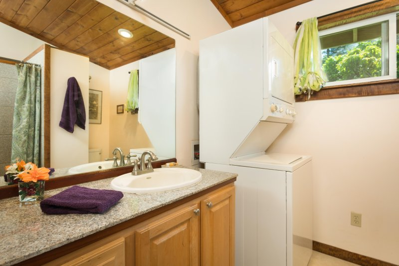 Bathroom with washer and dryer