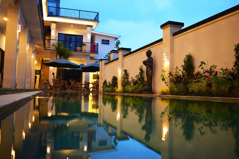An exquisite pool with modern balinese architecture with very comfortable ambiance