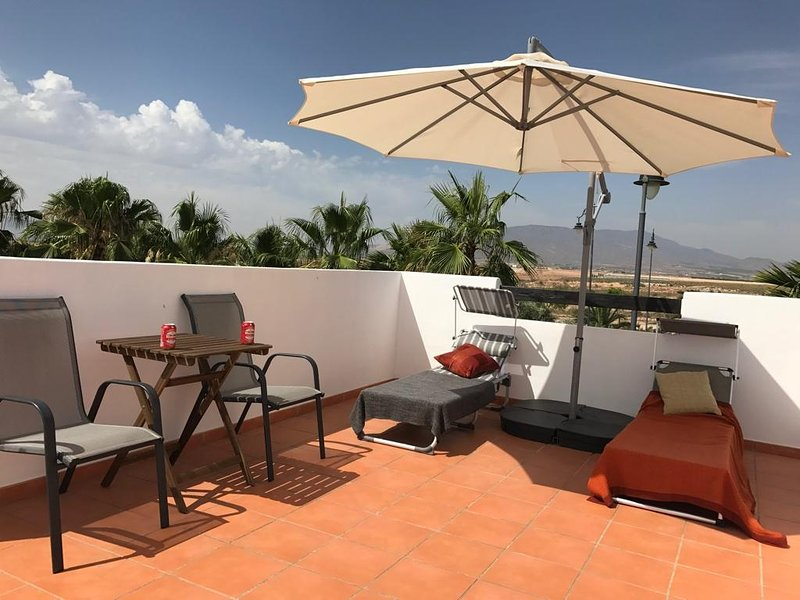 Relax on the large private roof terrace/solarium