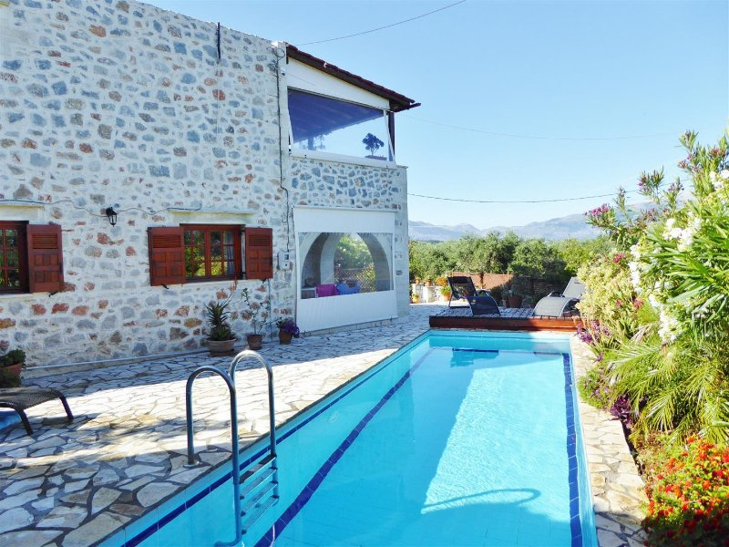 Great pool with shower and sunbathing area with furniture.