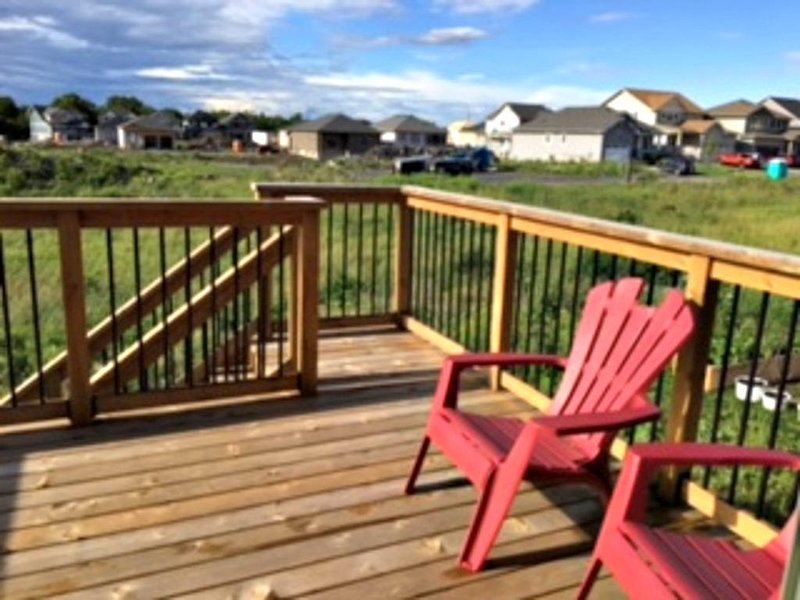 Spacious deck with BBQ, patio table with 4 chairs and Two Adirondack Chairs