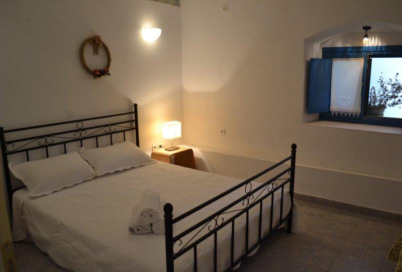 cama de matrimonio del dormitorio principal