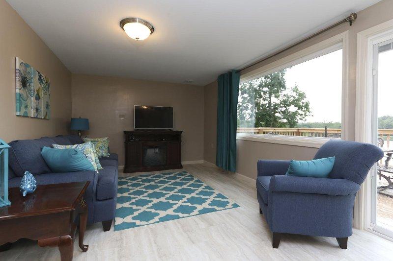 Habitación Familiar con sofá-cama, Vista al lago, chimenea eléctrica, y TV w / DVD
