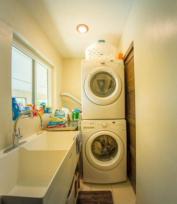 Separate laundry room with front loading washer and dryer