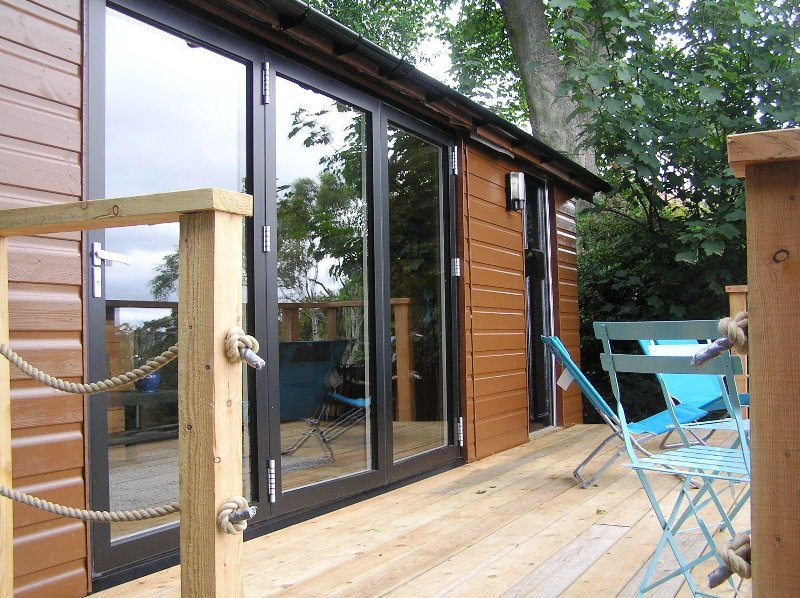 The front of the Cabin, its bi-fold doors and deck