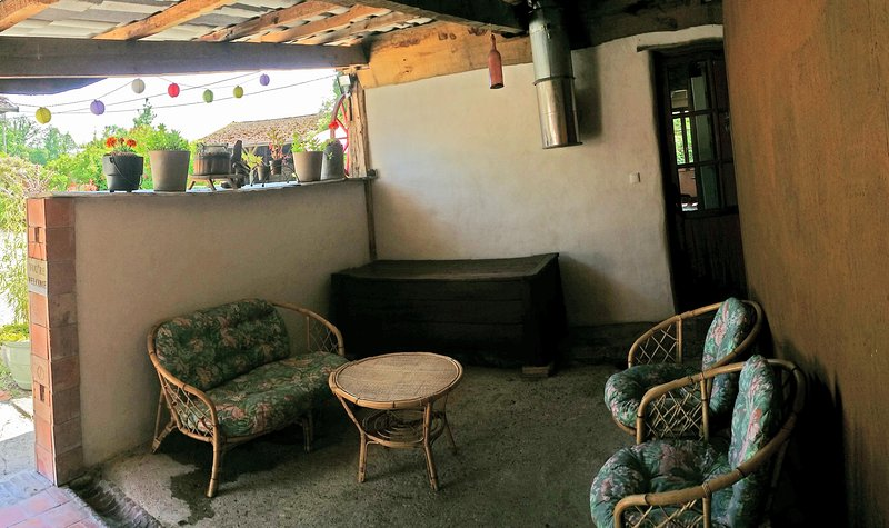 The covered patio with entrance to the kitchen