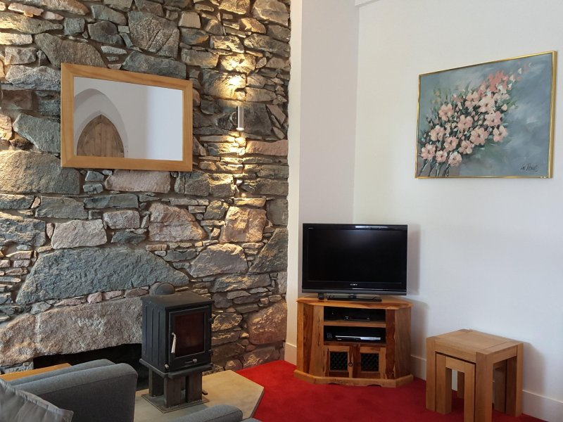Spacious living room with wood burning stove, 32' TV, DVD player.