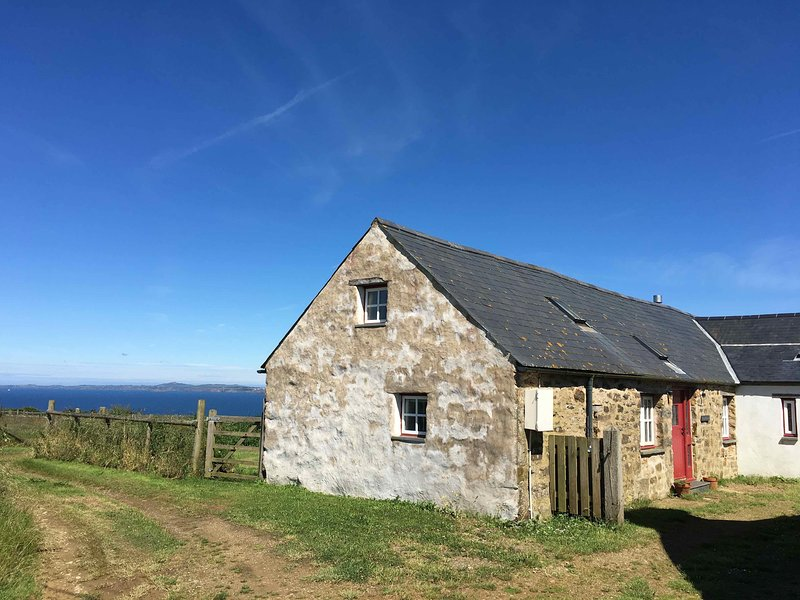 The Old Granary at Shortlands Farm enjoys spectacular sea views over St Brides Bay in Pembroke