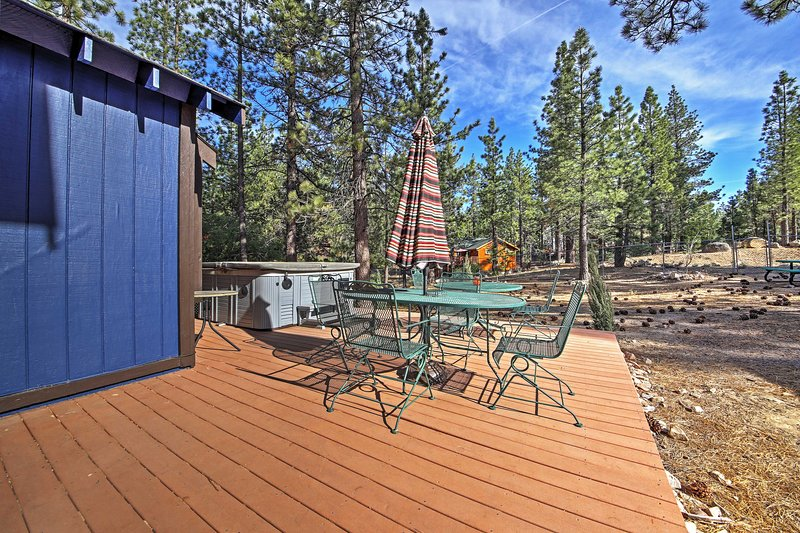 Relax on the deck of this 5-bedroom, 4-bath vacation rental house in Big Bear.