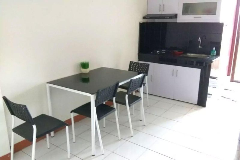 Kitchenette and dining set in the living room