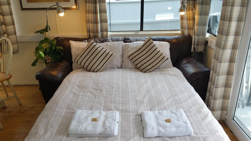 Sofa bed in saloon/lounge (opened and made up as a double bed)