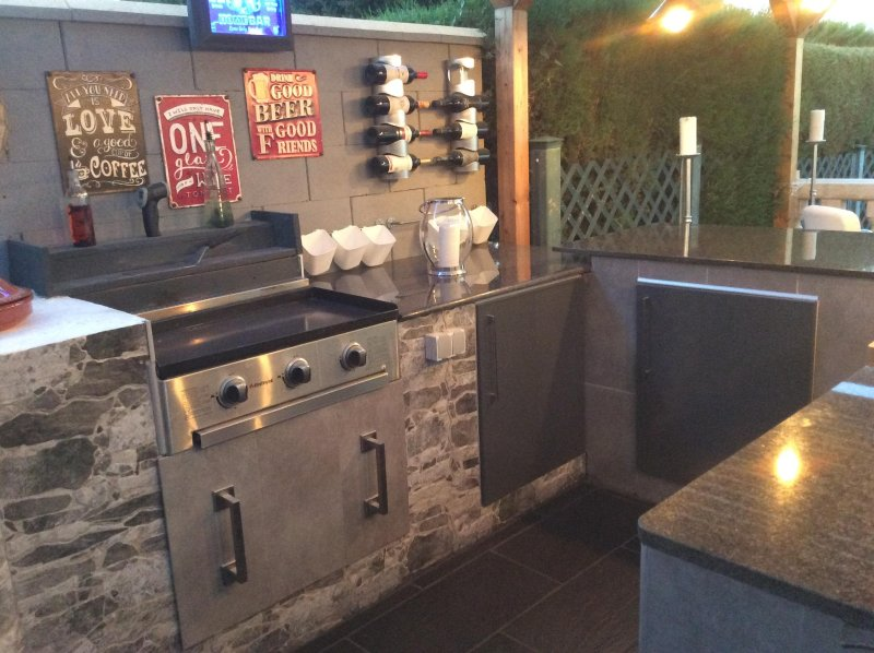 Our outdoor kitchen with wood burning oven, charcoal BBQ, gas griddle and fridge