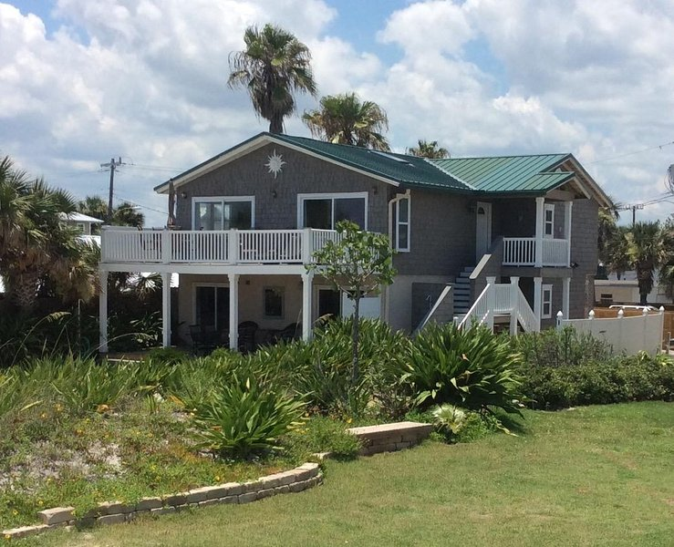 View of house from beach. 2 ocean facing covered porches and a large ocean facing balcony deck.