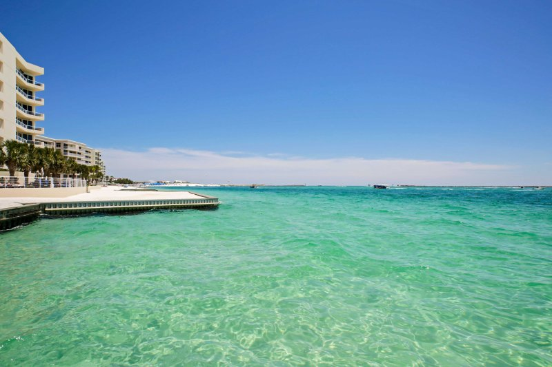 Emerald green Gulf of Mexico waters await you at this beachfront Destin condo!