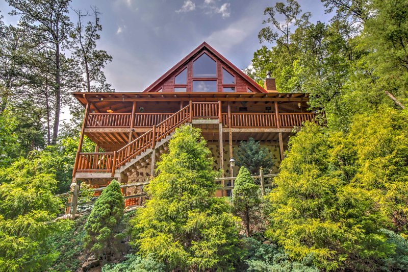 This large Gatlinburg vacation rental cabin is nestled in a dense, beautiful forest.