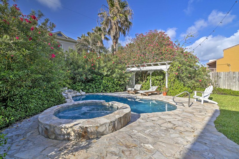 You and your travel companions can look forward to spending balmy days by this private pool and hot tub.