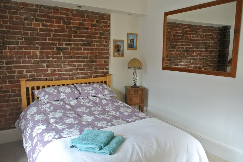 Master Bedroom with comfy king size bed.  A travel cot is also available