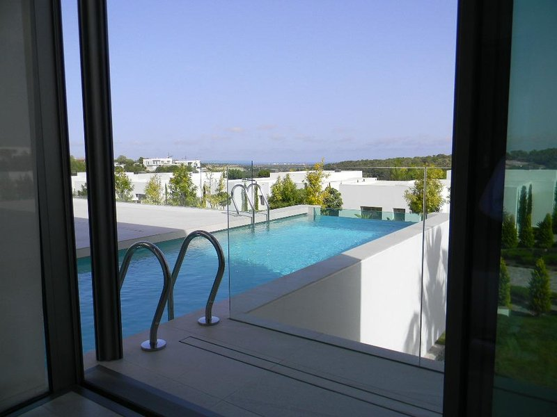 Private terrace from master bedroom with direct pool access