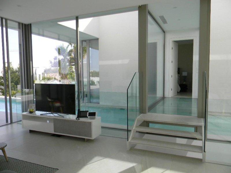 Glass bridge to master bedroom suite