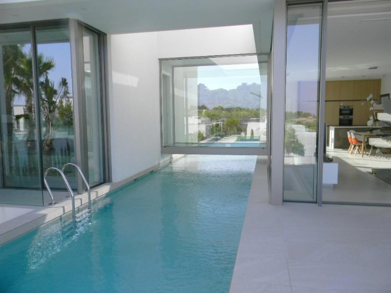 Pool separates lounge and master bedroom