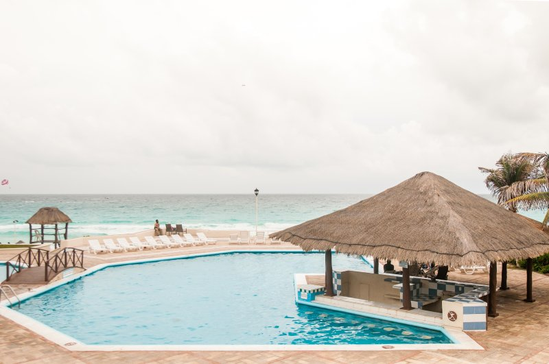 Main pool, includes bar under palapa.