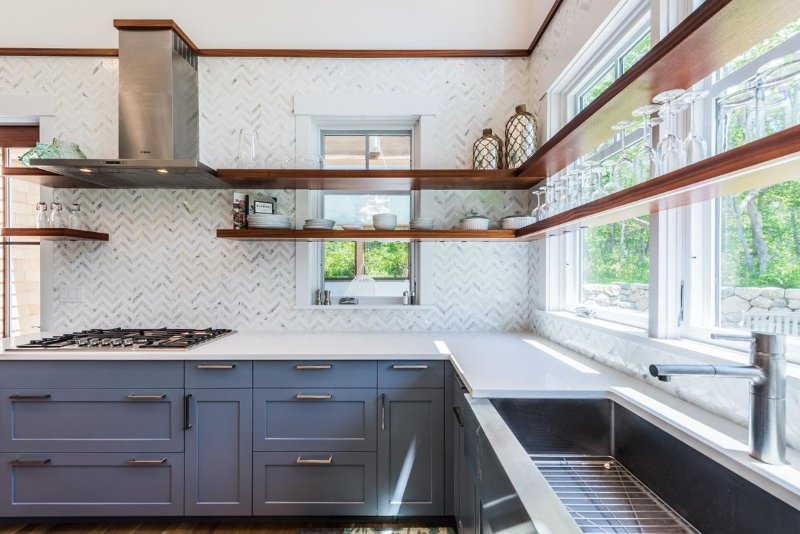Kitchen with center prep island and breakfast bar. professional appliances