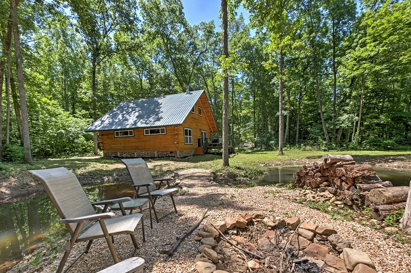 The cabin is on a 15-acre farm with pigs, chickens, a stocked pond and stream.