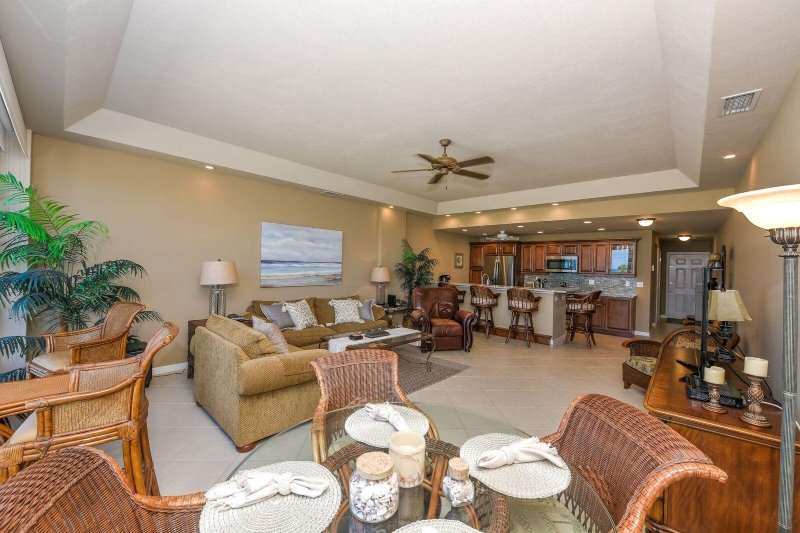 Enjoy the large living area with new open kitchen.  The couch has a full bed and chair a twin bed