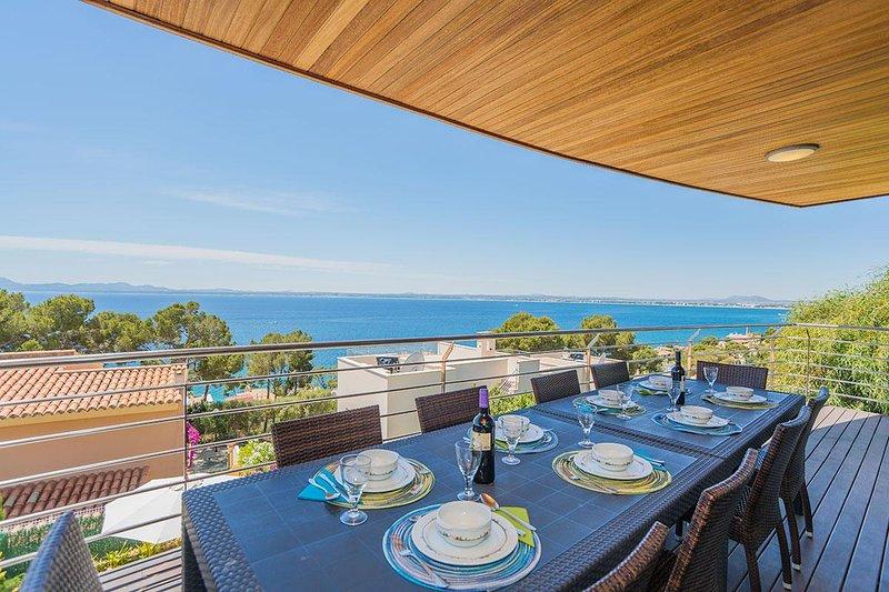 Gorgeous House in Alcanada, alquiler de vacaciones en Port d'Alcudia
