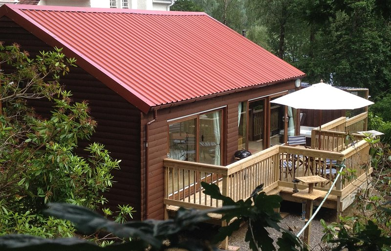 Cruachan Lodge with it's private decking and undercover hot tub area
