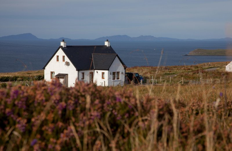 Tir nan Og Cottage overlooking the sea and Outer Isles. Cosy fire, underfloor heating. Peace. Quiet.