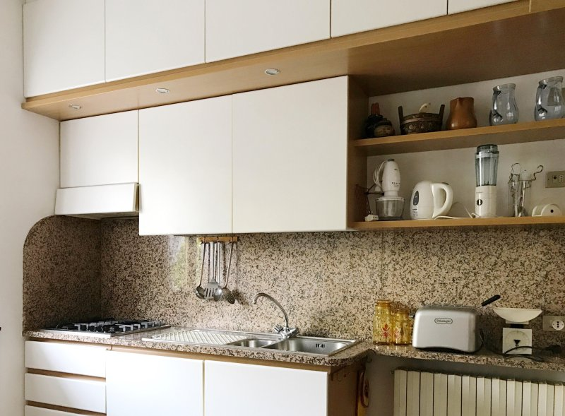 The spacious kitchen is equipped with every comfort