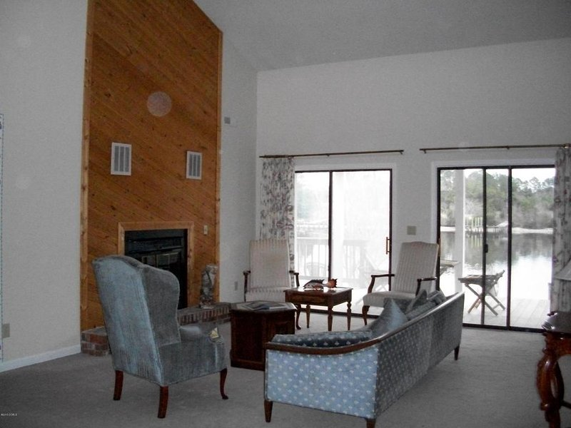 Living room with fireplace and vaulted ceiling