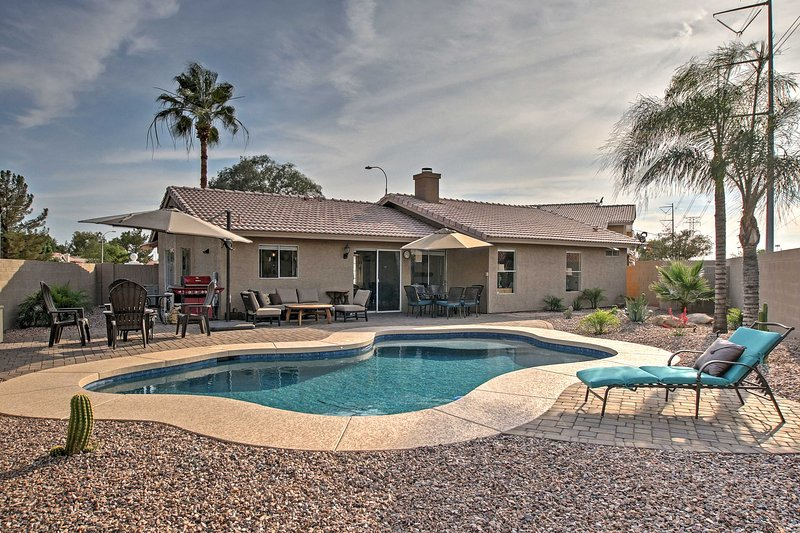 This 3-bedroom, 2-bathoom vacation rental house in Gilbert boasts a pristine backyard pool!