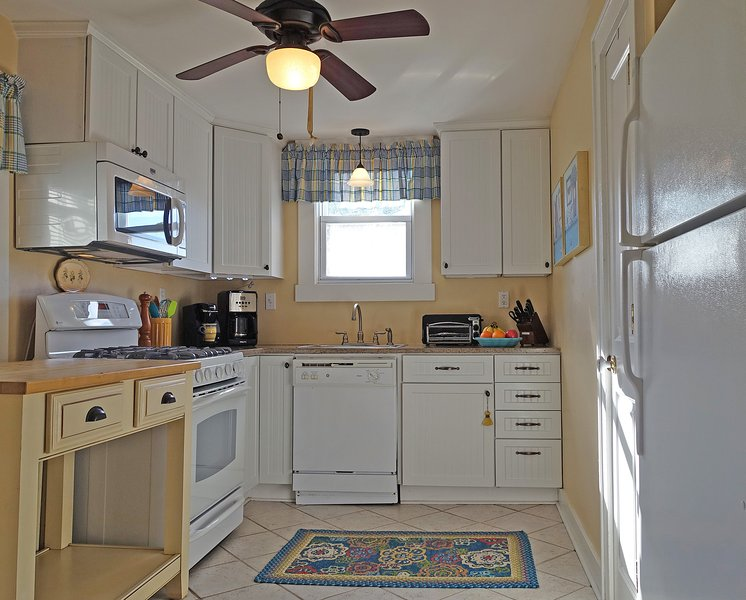 Spacious, bright and fully equipped kitchen at the Blue Hydrangea Beach Cottage rental.