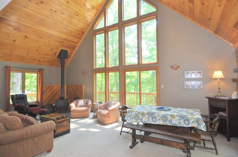 The Open Living Area - The large chalet windows welcome the warm natural light into the cabin.